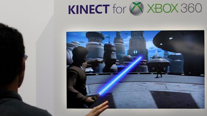 A visitor demonstrates Microsoft's Kinect for Xbox 360 home console at the Tokyo Game Show in Chiba, east of Tokyo Thursday, Sept. 15, 2011 during a media preview. (AP Photo/Koji Sasahara)