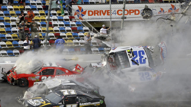 Kyle Larson (32) is airborne after a multi-car crash, including Parker Kilgerman (77), Justin Allgaier (31) and Brian Scott (2) during the final lap of the NASCAR Nationwide Series auto race at Daytona International Speedway, Saturday, Feb. 23, 2013, in Daytona Beach, Fla. Larson's car collided with the catch fencing. (AP Photo/John Raoux)