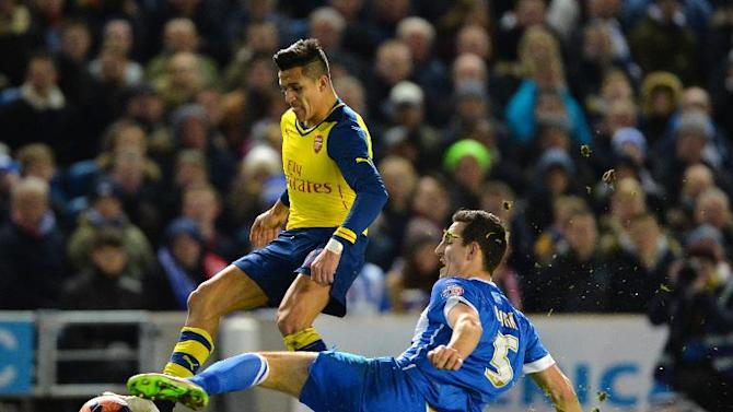 Brighton's Lewis Dunk (R) challenges Arsenal's Alexis Sanchez during their FA Cup match in Brighton on January 25, 2015