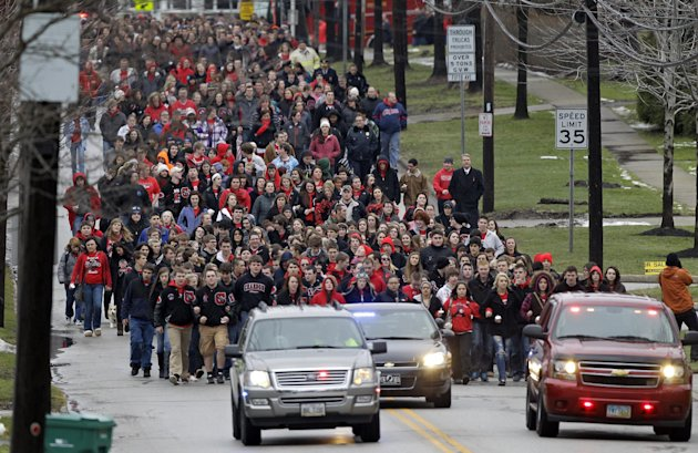 Chardon High School students march to the square in Chardon, Ohio for a memorial ceremony for three classmates who died in a school shooting rampage one year ago, Wednesday, Feb. 27, 2013. The march ended at the courthouse where 18-year-old shooter T.J. Lane pleaded guilty to all charges Tuesday. He could face life in prison at his sentencing March 19. (AP Photo/Mark Duncan)