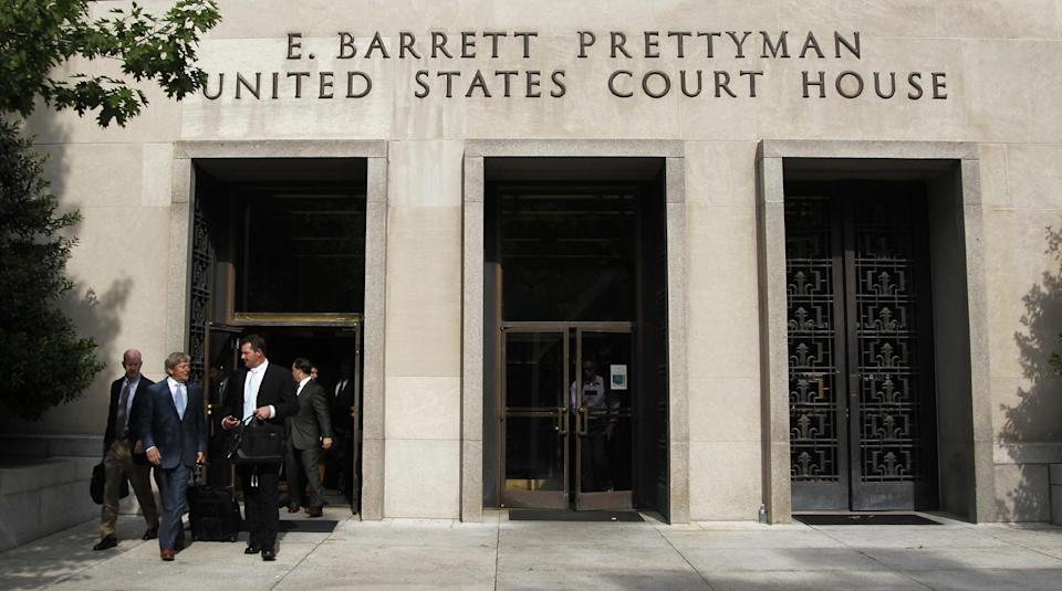 Former Major League Baseball pitcher Roger Clemens, right, leaves the E. Barrett Prettyman United States Court House, Tuesday, May 1, 2012, in Washington. (AP Photo/Haraz N. Ghanbari)