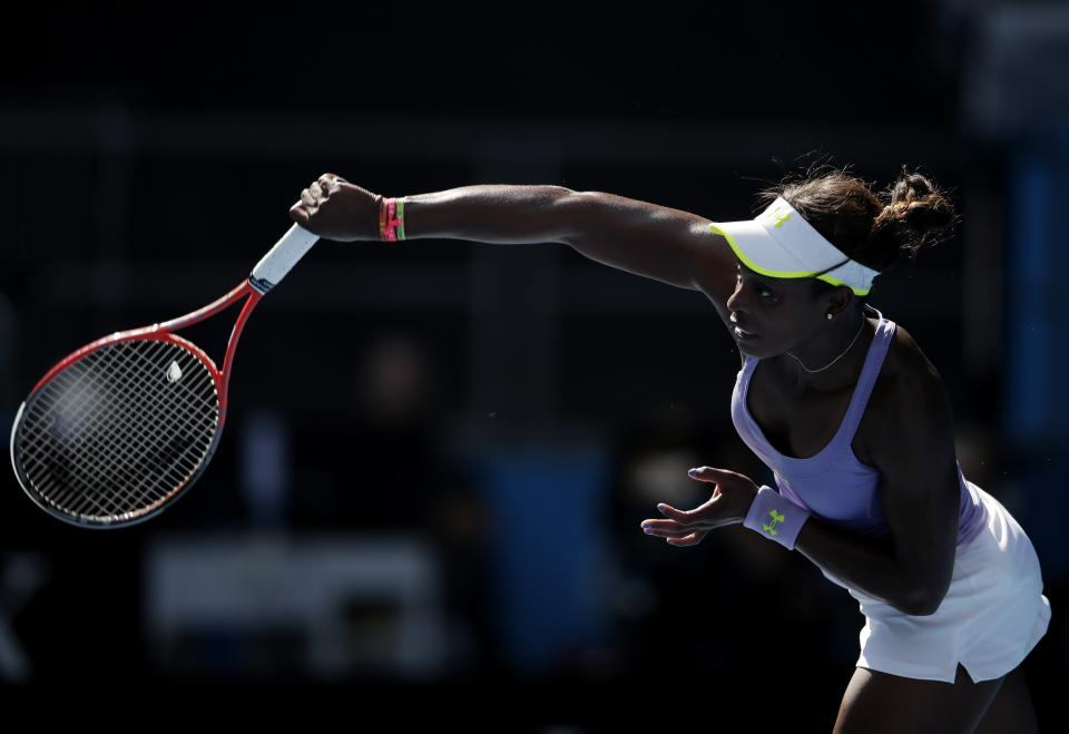 Sloane Stephens of the US serves to Serbia's Bojana Jovanovski during their fourth round match at the Australian Open tennis championship in Melbourne, Australia, Monday, Jan. 21, 2013. (AP Photo/Rob Griffith)