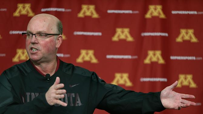 """The University of Minnesota football coach Jerry Kill speaks to the media during a news conference on campus regarding his raise, and spring football, Monday, Feb. 24, 2014 in Minneapolis, Minn. Kill says he's """"getting paid way too much"""" to be Minnesota's coach but appreciative of the raise and contract extension he received"""