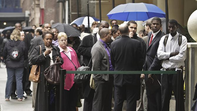 In this Wednesday, Oct. 24, 2012 photo, job seekers wait in line to see employers at the National Career Fairs' job fair in New York. According to government reports released Friday, Nov. 2, 2012, the U.S. economy added 171,000 jobs in October, and the unemployment rate ticked up to 7.9 percent. (AP Photo/Bebeto Matthews)