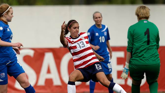 Alex Morgan, center, of the US, passes to teammate Abby Wambach, unseen, to score their third goal against Iceland during their Algarve Cup  women's soccer match Wednesday, March 6, 2013, in Albufeira, southern Portugal. (AP Photo/Armando Franca)
