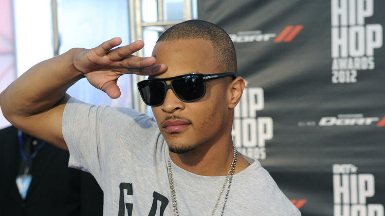 T.I. attends the red carpet at the BET Hip-Hop Honors at Boisfeuillet Jones Atlanta Civic Center on Saturday, Sept. 29, 2012, in Atlanta. (Photo by John Amis/Invision/AP)
