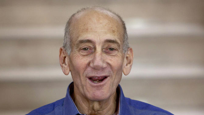 FILE - In this July 10, 2012 file photo, Former Israeli Prime Minister Ehud Olmert speaks to the media after hearing the verdict in his trial, in Jerusalem's District Court. Olmert was found guilty Monday, March 30, 2015,  of fraud and breach of trust in a retrial on corruption charges, three years after being acquitted. (AP Photo/Ariel Schalit, File)