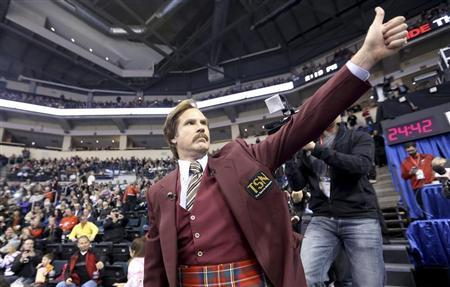 Will Ferrell as Ron Burgundy salutes the crowd at the Roar of the Rings Canadian Olympic Curling Trials in Winnipeg