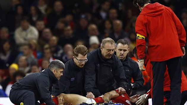 Wales' Leigh Halfpenny is treated for an injury during their international rugby union match against Australia at the Millenium Stadium