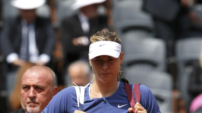 Maria Sharapova of Russia walks on the court as she arrives for the women's singles match against Samantha Stosur of Australia at the French Open tennis tournament at the Roland Garros stadium in Paris