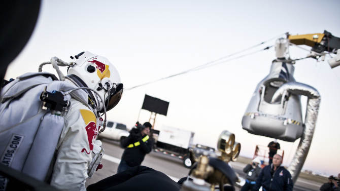 In this photo provided by Red Bull, Pilot Felix Baumgartner of Austria steps out from his trailer during the final manned flight for Red Bull Stratos in Roswell, N.M. on Saturday, Oct. 14, 2012.  Baumgartner plans to jump from an altitude of 120,000 feet, an altitude chosen to enable him to achieve Mach 1 in free fall, which would deliver scientific data to the aerospace community about human survival from high altitudes.(AP Photo/Red Bull, Balazs Gardi)