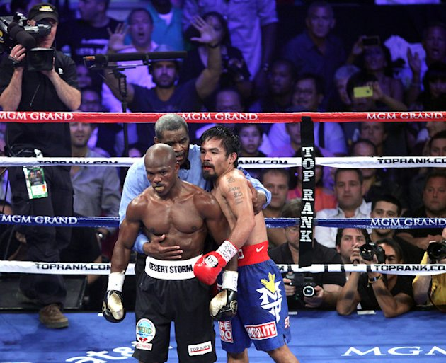 Timothy Bradley (L) Of The US And Manny Pacquiao (R) Of The Philippines Are Guided To Their Coners By By Referee Robert  AFP/Getty Images