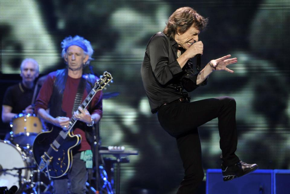 "Mick Jagger, right, and bandmates Keith Richards, center, and Charlie Watts of the Rolling Stones perform on the kick-off of the band's ""50 and Counting"" tour at the Staples Center on Friday, May 3, 2013 in Los Angeles. (Photo by Chris Pizzello/Invision/AP)"