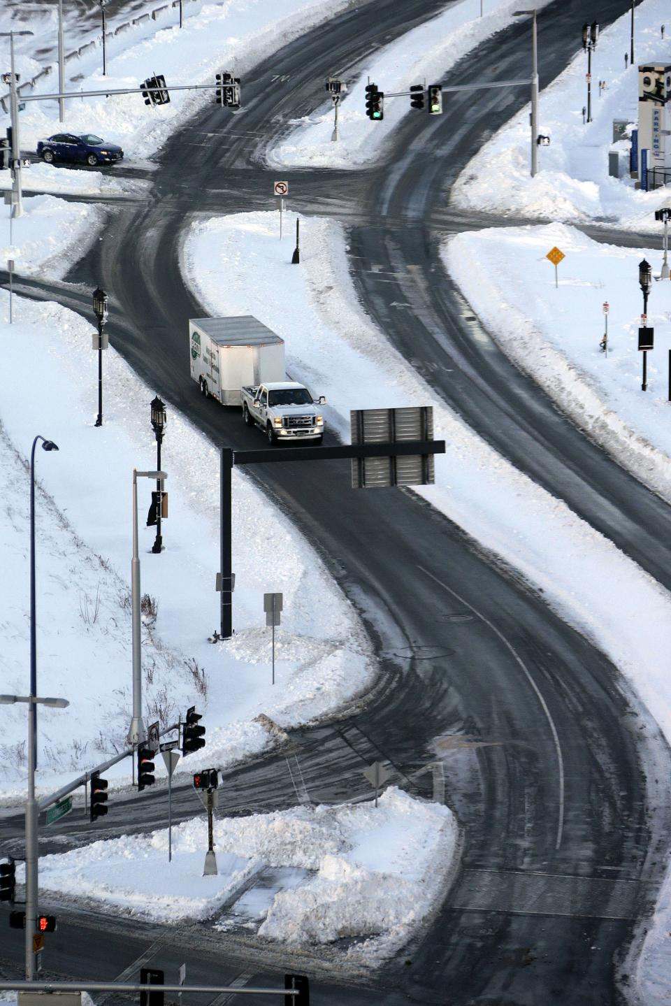 The roads in the Seaport area of Boston are clear and open early Sunday morning, Feb. 10, 2013. A snow storm dumped more than two-feet of snow in the area Friday night and Saturday. (AP Photo/Gene J. Puskar)