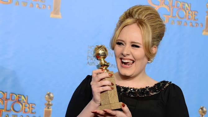 """Adele poses with the award for best original song in a motion picture for """"Skyfall"""" backstage at the 70th Annual Golden Globe Awards at the Beverly Hilton Hotel on Sunday Jan. 13, 2013, in Beverly Hills, Calif. (Photo by Jordan Strauss/Invision/AP)"""