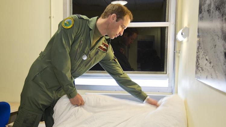 "This is an undated handout photo issued by www.dukeanduchessofcambridge.org on Tuesday Nov. 20, 2012 of Britain's Prince William making his bed whilst working as a helicopter search and rescue pilot at RAF Valley on Anglesey, Wales. The picture show a typical ""day in the life"" for Prince William in his work flying RAF Sea King helicopters from their base at RAF Valley on Anglesey, north Wales. From planning and preparing for any emergency callout to resting with his colleagues during ""downtime"", the exclusive pictures give an insight into the life of Flight Lieutenant Wales in his day-job as a Search and Rescue (SAR) pilot. (AP Photo/ SAC Faye Storer/MoD, www.dukeanduchessofcambridge.org) NO ARCHIVE  EDITORIAL USE ONLY"