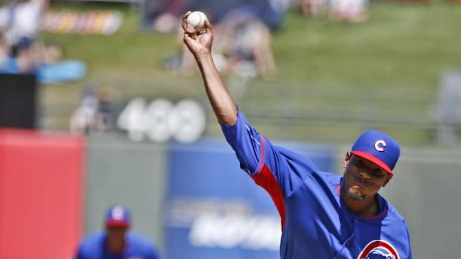 Chicago Cubs starting pitcher Edwin Jackson works the first inning against the Kansas City Royals in a spring training baseball game  Sunday, March 29, 2015, in Surprise, Ariz.  (AP Photo/Lenny Ignelzi)