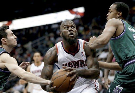 Teague, Horford lead Hawks past Bucks 98-90