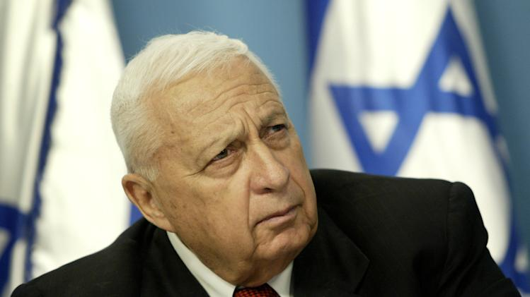 FILE - In this Sunday May 16, 2004 file photo, Israeli Prime Minister Ariel Sharon pauses during a news conference in his Jerusalem office regarding education reform. Sharon, the hard-charging Israeli general and prime minister who was admired and hated for his battlefield exploits and ambitions to reshape the Middle East, died Saturday, Jan. 11, 2014. The 85-year-old Sharon had been in a coma since a debilitating stroke eight years ago. (AP Photo/Oded Balilty, File)
