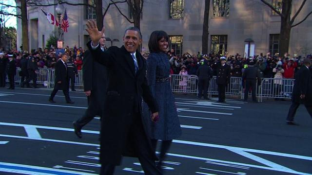 Obamas walk down Pennsylvania Avenue in 2013 inaugural parade