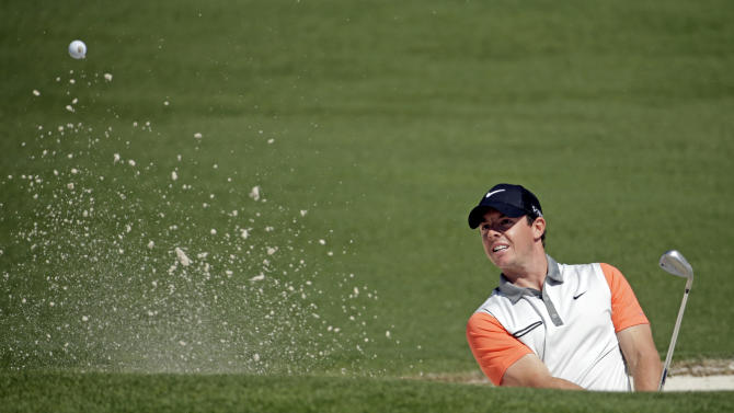 Rory McIlroy, of Northern Ireland, hits out of a bunker on the second green during the first round of the Masters golf tournament Thursday, April 10, 2014, in Augusta, Ga. (AP Photo/Chris Carlson)