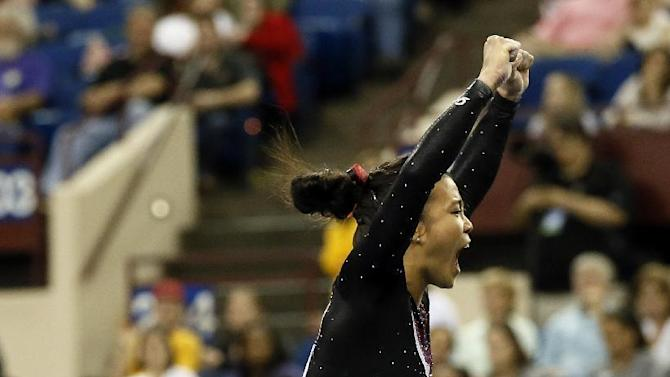 Stanford's Ivana Hong celebrates after competing on the balance beam during the NCAA women's gymnastics championships Saturday, April 18, 2015, in Fort Worth, Texas. (AP Photo/Tony Gutierrez)