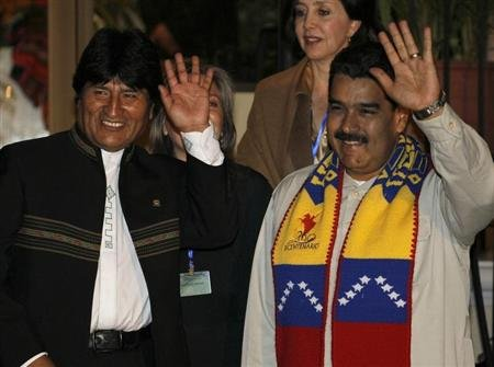 Bolivia's President Evo Morales and his Venezuelan counterpart Nicolas Maduro wave during a meeting in Cochabamba