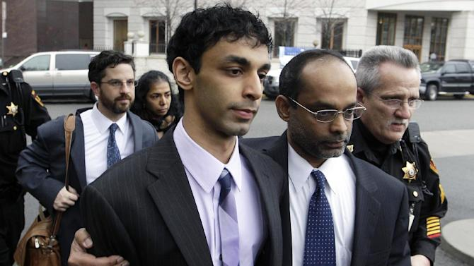 Dharun Ravi, center, is helped by his father, Ravi Pazhani, second right, as they leave court around  in New Brunswick, N.J., Friday, March 16, 2012. Defense attorney Philip Nettl follows, second left.  Ravi, a former Rutgers University student accused of using a webcam to spy on his gay roommate's love life has been convicted of bias intimidation and invasion of privacy. A jury found that he used a webcam to spy on roommate Tyler Clementi.  Within days, Clementi realized he had been watched and jumped to his death from New York's George Washington Bridge in September 2010.   (AP Photo/Mel Evans)