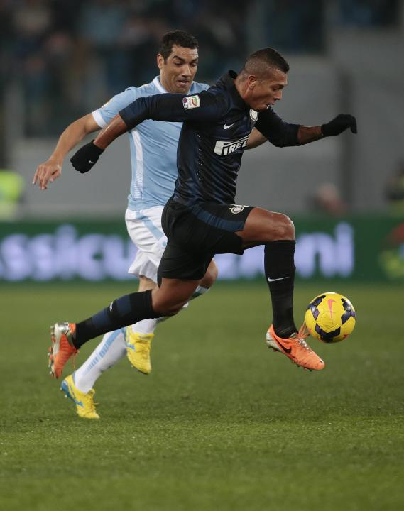 Inter Milan's Fredy Guarin is challenged by Lazio's Andre Dias during their Italian Serie A soccer match at the Olympic stadium in Rome