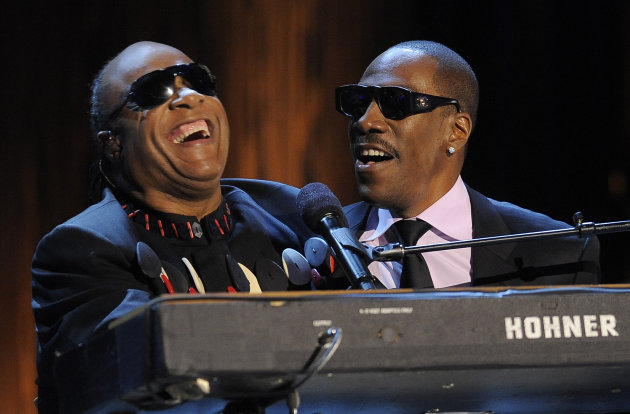 Stevie Wonder, left, is joined by Eddie Murphy to sing Wonder&#39;s song &quot;Higher Ground&quot; onstage during &quot;Eddie Murphy: One Night Only,&quot; a celebration of Murphy&#39;s career at the Saban Theater on Saturday, Nov. 3, 2012, in Beverly Hills, Calif. (Photo by Chris Pizzello/Invision)