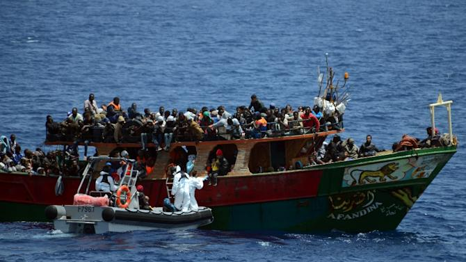 A French Navy patrol ship rescues migrants aboard a fishing boat in the Mediterranean Sea, on May 20, 2015