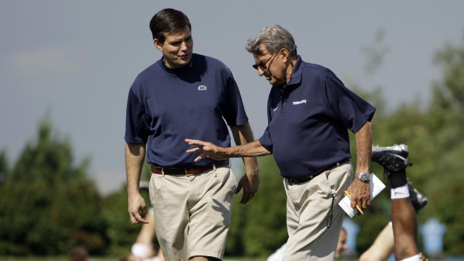 FILE - In this Aug. 8, 2008, file photo, Penn State football coach Joe Paterno, right, walks with his son and quarterback coach Jay Paterno as players stretch out during NCAA college football practice in State College, Pa. A new era is dawning at Penn State, with a new football coach and a new look to the uniforms.  But no Paterno on the sideline in a season opener for the first time since 1965. Penn State plays Ohio on Saturday. (AP Photo/Carolyn Kaster, File)