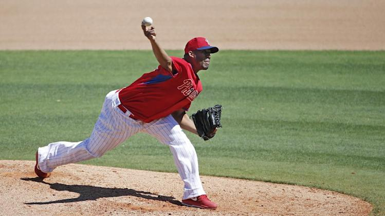 Philadelphia Phillies starting pitcher Roberto Hernandez delivers in the fifth inning of an exhibition spring  baseball game against the split squad New York Yankees in Clearwater, Fla., Thursday, March 13, 2014.  Hernandez allowed one hit in five innings