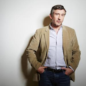 """This April 2, 2014 photo shows English comedian, writer and actor Steve Coogan, from the upcoming film """"Alan Partridge,"""" in New York. (Photo by Dan Hallman/Invision/AP)"""