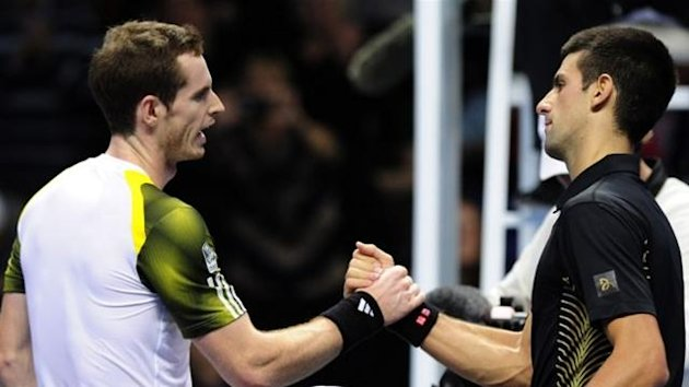 Andy Murray shakes hands with Novak Djokovic after their ATP World Tour Finals match in London on November 7
