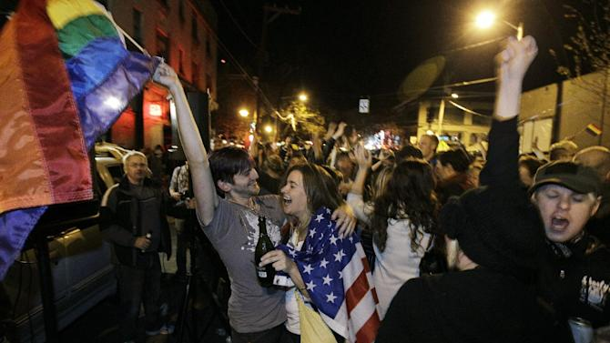 Revelers display U.S. and gay pride flags as they celebrate early election returns favoring Washington state Referendum 74, which would legalize gay marriage, during a large impromptu street gathering in Seattle's Capitol Hill neighborhood, in the early hours of Wednesday, Nov. 7, 2012. For years, foes of same-sex marriage had a potent talking point: They'd won every time the issue went to a popular vote. That winning streak has now been shattered in a multi-state electoral sweep by gay marriage supporters. It's a historic tipping point likely to influence other states and possibly even the Supreme Court. (AP Photo/Ted S. Warren)