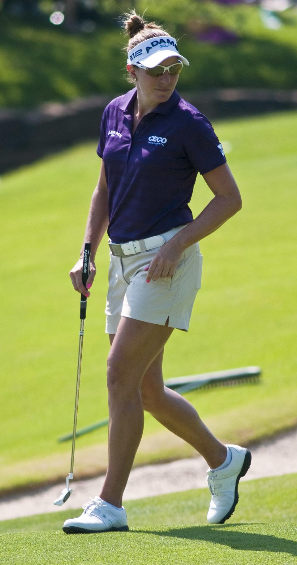 Brittany Lang surveys the 15th green before putting in the second round of the LPGA NW Arkansas Championship golf tournament in Rogers, Ark., Saturday, June 30, 2012. (AP Photo/April L. Brown)