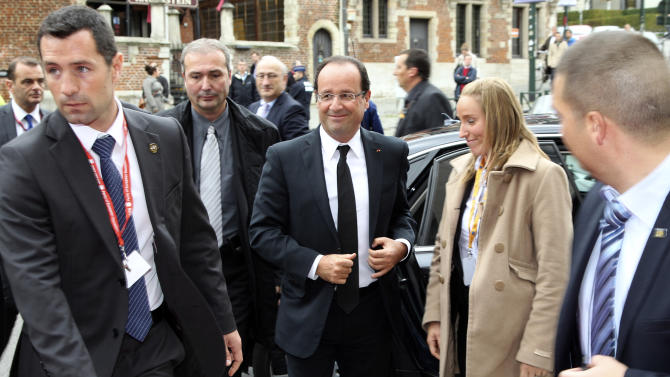 French President Francois Hollande, center, arrives for a meeting of European Socialist Party leaders prior to an EU summit in Brussels on Thursday, Oct. 18, 2012. European leaders are gathering again in Brussels to discuss how to save the euro currency from collapse and support countries facing too much debt and not enough growth. (AP Photo/Yves Logghe)