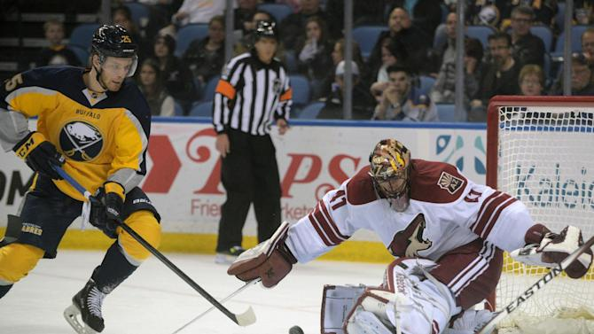 Buffalo Sabres' Mikhail Grigorenko (25), of Russia, backhands a shot against Arizona Coyotes' Mike Smith (41) during the first period of an NHL hockey game Thursday, March 26, 2015, in Buffalo, N.Y. (AP Photo/Gary Wiepert)