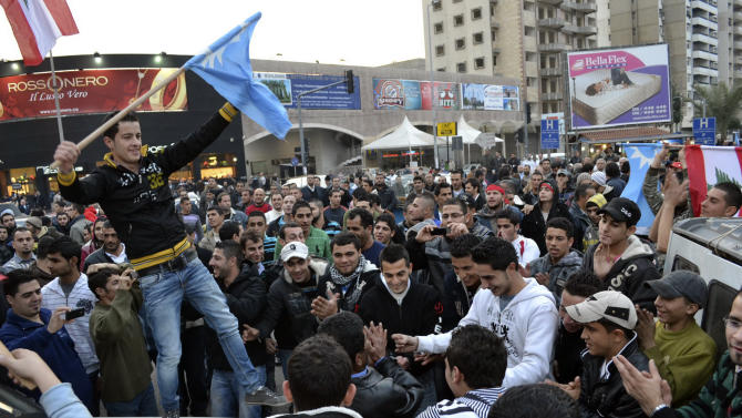 Supporters of Lebanese caretaker Prime Minister Saad Hariri chant slogans during a protest in the northern port city of Tripoli, Lebanon, Monday, Jan. 24, 2010. Hezbollah secured the support from a majority of parliament Monday to nominate its candidate Najib Mikati for prime minister, putting the Iranian-backed militant group in position to control Lebanon's new government. Several hundred Hariri supporters in Tripoli, a predominantly Sunni area and a hotbed of fundamentalists, staged protests chanting anti-Mikati slogans. (AP Photo)