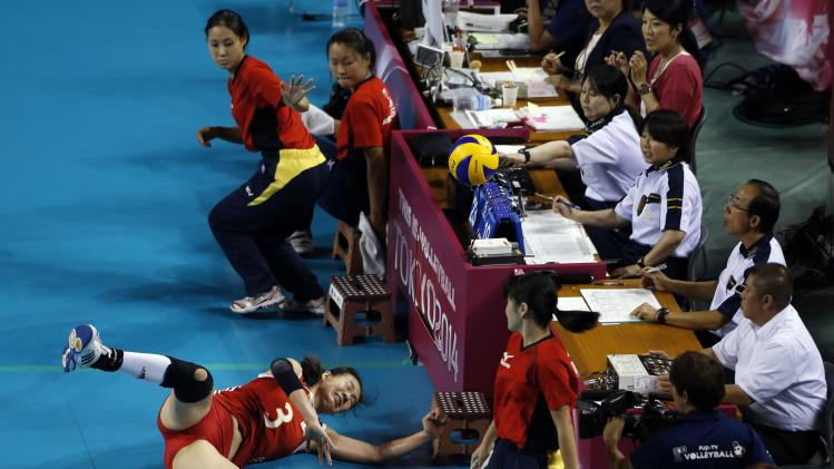 Yang of China fails to receive the ball during their FIVB Women's Volleyball World Grand Prix 2014 final round match against Japan in Tokyo