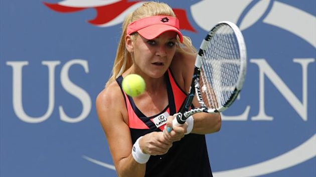 Agnieszka Radwanska of Poland hits a return to Anastasia Pavlyuchenkova of Russia at the U.S. Open tennis championships in New York August 30, 2013 (Reuters)