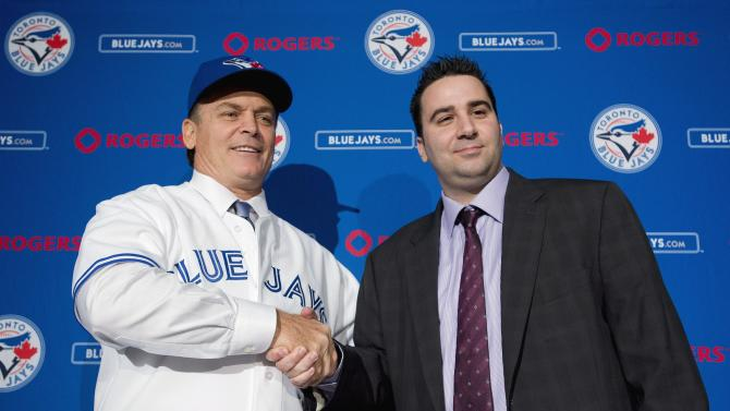 Toronto Blue Jays General Manager Alex Anthopoulos, right, shakes hands with new Blue Jays manager John Gibbons, left, after speaking to he media during a press conference in Toronto on Tuesday, Nov. 20, 2012. (AP Photo/The Canadian Press, Nathan Denette)