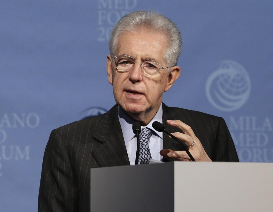 Italian Prime Minister Mario Monti delivers his speech Italy's stock exchange market during a meeting in Milan, Italy, Monday, Nov. 12, 2012. (AP Photo/Antonio Calanni)