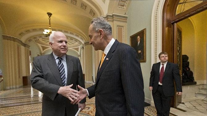 """Sen. John McCain, R-Ariz., left, and Sen. Charles Schumer, D-N.Y., right, two of the authors of the immigration reform bill crafted by the Senate's bipartisan """"Gang of Eight,"""" shakes hands on Capitol Hill in Washington, Thursday, June 27, 2013, prior to the final vote. The historic legislation would dramatically remake the U.S. immigration system and require a tough new focus on border security. (AP Photo/J. Scott Applewhite)"""