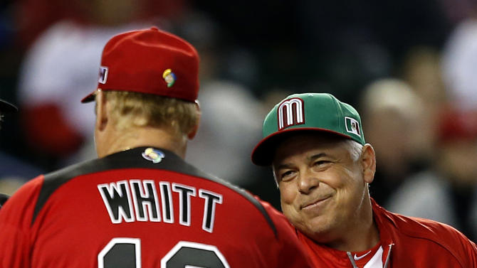 Canada manager Ernie Whitt (12) and Mexico manager Rick Renteria greet each other before a World Baseball Classic game on Saturday, March 9, 2013, in Phoenix. (AP Photo/Matt York)