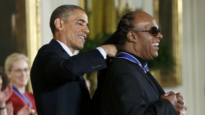 U.S. President Obama presents the Presidential Medal of Freedom to  singer Wonder during a White House ceremony in Washington