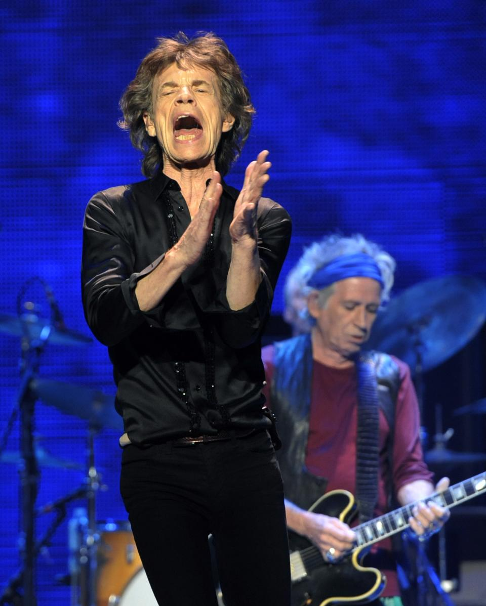 "Mick Jagger, left, and Keith Richards of the Rolling Stones perform at the kick-off of the band's ""50 and Counting"" tour at the Staples Center on Friday, May 3, 2013 in Los Angeles. (Photo by Chris Pizzello/Invision/AP)"