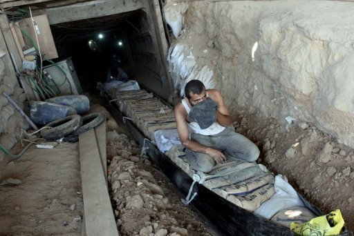 Palestinians transport bags of cement through smuggling tunnels under the Gaza-Egypt border in Rafah. Egypt's closure of scores of cross-border smuggling tunnels has affected the flow of goods into Gaza but has not dealt the knockout blow widely expected by traders and officials