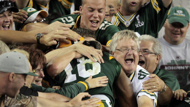 Green Bay Packers' Randall Cobb (18) celebrates with fans after a 108-yard touchdown run on a kickoff during the second half of an NFL football game against the New Orleans Saints Thursday, Sept. 8, 2011, in Green Bay, Wis. The Packers won 42-34. (AP Photo/Mike Roemer)